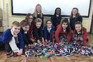 Pupils are write on with recycling