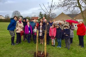 Family, friends and teaching colleagues gathered at the school for the tree planting.