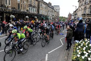Harrogate crowds greet Tour de Yorkshire riders last Friday on Parliament Street, part of the town centre circuit which will play a key role in the UCI Road World Championships in September.