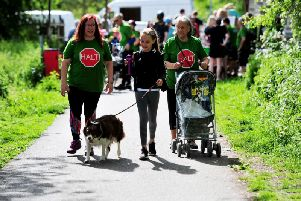 Three generations of campaigners against a Nidd Gorge relief road - From left Adele Laurie, Aysha Laurie aged 11 with Poppy the dog and Brenda Laurie at Andrew Jones MP's walk. (Picture: Gerard Binks)