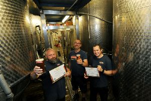 Daleside Brewery has won more top brewery awards for its popular range of beers. Pictured from left Colin Shiel, Craig Witty and Rob Millechamp with pints and awards in the brewery. (Picture by Gerard Binks)