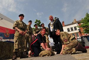 The Mayor and Mayoress of Ripon, Eamon Parkin and Sarah Henry, have a go at first aid with the Ripon Army Cadets.