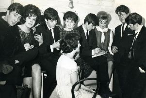 The Beatles pictured back stage with fans at Harrogates Royal Hall in 1963. (Picture by Terry Mason)