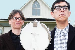 Playing an intimate gig in the Harrogate district - Americana duo Hungrytown in a pose inspired by the iconic painting American Gothic by Grant Wood.