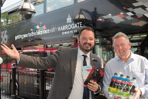 Bus boost during UCI cycling championships - Harrogate Water sales and marketing director Rob Pickering, right, with The Harrogate Bus Companys CEO Alex Hornby.