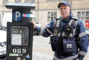 Civil Enforcement Officer Andy with his new body camera. Sheffield Council has spent 23,000 in a bid to cut down on violent incidents. Picture: George Torr/The Star