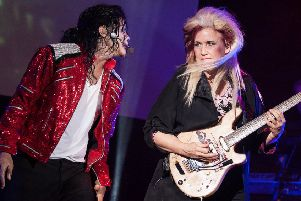 Navi And Jennifer Batten during aMichael Jackson King Of Pop concert.