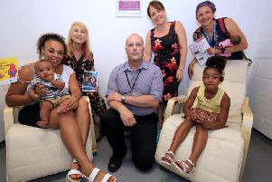 Roxanne Reid, Rhyder Ramsey, aged 17 weeks, Renyeyah Ramsey, six, Coun Jackie Drayton, Coun Dawn Dale, Richard Arnold, acting assistant manager at The Moor Market, and Heather Sawrey from Jessop Wing.
