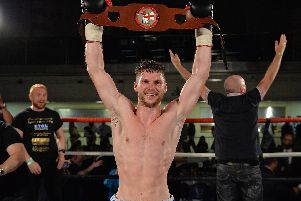 Lee Appleyard celebrates with the English lightweight title. Pic: Dean Woolley