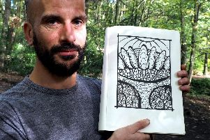 Tom Beaumont with a drawing of trees & paths