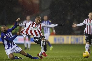 Sheffield United manager Chris Wilder loves how his team, including Leon Clarke, approach their football: Simon Bellis/Sportimage