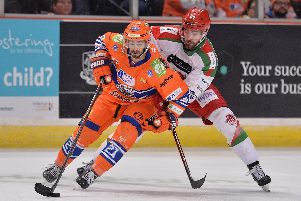 Sheffield Steelers player Justin Buzzeo in action against Cardiff Devils