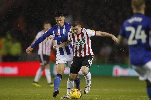 John Fleck takes charge of the midfield during Sheffield United's game against Sheffield Wednesday: Simon Bellis/Sportimage