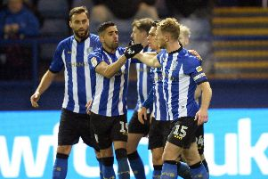 Owls skipper Tom Lees is congratulated for scoring the winner against Bolton
