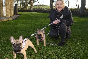 Lisa Leighton with her two dogs Coco and Mabel.