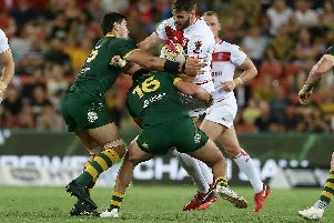 England's Alex Walmsley is tackled during the Rugby League World Cup final between Australia and England, Suncorp Stadium, Brisbane, Australia, December 2, 2017. Picture: Tertius Pickard