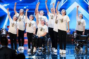 Hollie Booth - seated in the wheelchair - and RISE. Picture: ITV