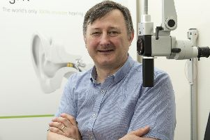 Audiologist Peter Byron at Thornbury Hospital in Sheffield with the Lyric hearing aid