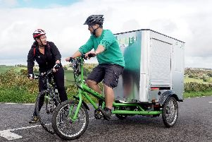Gareth Roberts of the Regather Trading Cooperative with his cargo e-bike taking catering equipment to an event in the Mayfield valley''Copyright David Bocking 2019, free use for stories relating to Love to Ride, The Outdoor City and cycling in South Yorkshire
