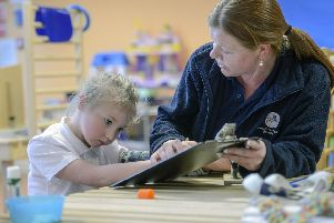 Feature on Paces, a Sheffield charity and school which supports children, adults and families with cerebral palsy and motor disorders, as it launches a campaign to raise 1 million to build a new home. Conductor Assistant Claire Walker with Lillie. Picture Scott Merrylees