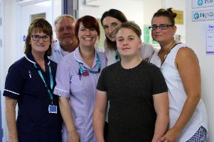 Marie Boyer (far right), Joe Boyer (second right), Dad Neil Boyer (second left) and some of the Emergency Department staff at Sheffield Childrens Hospital who treated him.