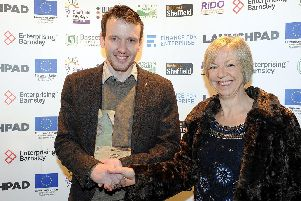 Winner Andrew Ashworth, IGO Pets, and Nance Maitland, of Derbyshire Dales District Councilat the Launchpad Awards 2018.