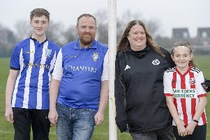 Stuart and Marie Hudson from Aston who are split over the upcoming derby game between the Blades and the Owls along with daughter Grace and son Rhys. Picture: Dean Atkins