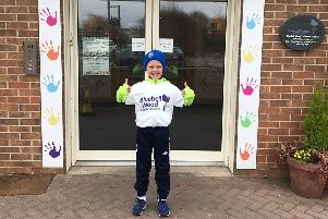 Shay O'Grady sets off on his 16-mile walk from Bluebell Wood Children's Hospice.