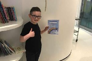 Charlie Leek, an eight-year-old brain tumour survivor from Sheffield who is to raise funds forSheffield Childrens Hospital to thank staff there for the care he received. He is pictured ringing the bell at the hospital to mark the end of his treatment.