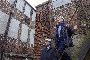 Coun Mazher Iqbal and former worker Philip Drury in Leah's Yard. Picture: Scott Merrylees