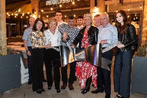 Alan and Wendy (centre) with members of the McGilveray family who were invited to cut the ribbon at the new restaurant.