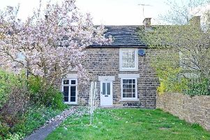 Lawned cottage garden with magnolia tree