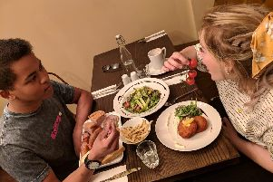 A couple enjoy a meal at the newly re-launched Edison and Co in Sheffield City Centre.