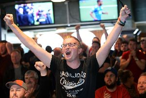 Blades fans celebrate in the Clubhouse, London Road after watching Leeds' draw with Villa on TV at Sunday lunchtime confirming Sheffield Uniteds promotion to the Premier League. Picture: Steve Ellis