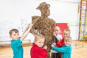 Bradfield Dungworth Primary School pupils with their willow sculpture depicting a World War Two veteran.