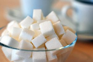 Sugar in food and soft drinks can cause obesity and diabetes.