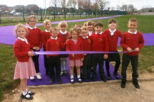 Happy youngsters cut the ribbon.