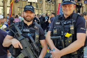 Armed officers mingle with the crowds at the gala.