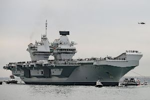 The Royal Navy's super-carrier HMS Queen Elizabeth. Picture by Steve Parsons/PA Wire