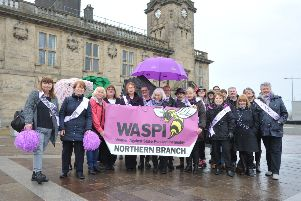 Members of WASPI (Women Against State Pension Inequality) celebrate International Women's Day.