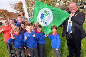 Throston Primary School eco council pupils, teacher Abby Davis and Hartlepool mayor Allan Barclay with the  Eco Schools Green Flag award.