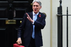 Chancellor Philip Hammond holding his red ministerial box outside 11 Downing Street, London, before heading to the House of Commons to deliver his Budget. Picture by: David Mirzoeff/PA Wire