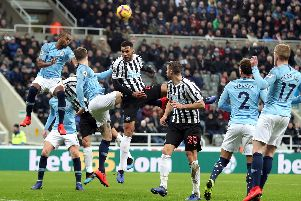 Jamaal Lascelles wins a header in Newcastle's recent win over Premier League champions Manchester City.