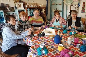 Volunteers creating crafts at WHIST