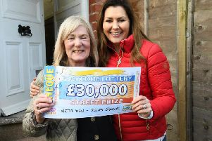 Elizabeth Adams with her cheque presented by Peoples Postcode Lottery ambassador Judie McCourt.