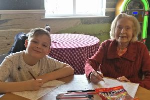 Nine-year-old Jamie Brown and 92-year-old Jessie Hannah create pictures during an arts and crafts session at Willowdene.