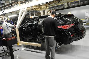 Workers build an Infiniti car on the line at Sunderland when the Q30 model was first launched in 2015.