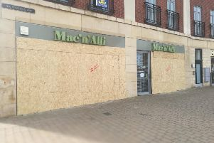 The cafe remains boarded up.