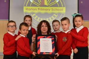Harton Primary School are winners of the poetry competition. Teacher Stephanie Robson with pupils from left Harley,6, Jacob, 5, Ella, 7, Max, 5, Ethan, 7 and Darcie, 7