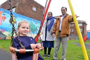Residents are unhappy on St Marks Play Area condition at Bedford Avenue, Laygate. Ali Hayder with wife Rahima Yesmin and local younster Emelia Graham, 4